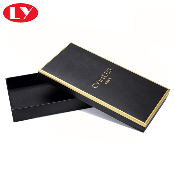 Black chocolate box packaging with gold foil logo