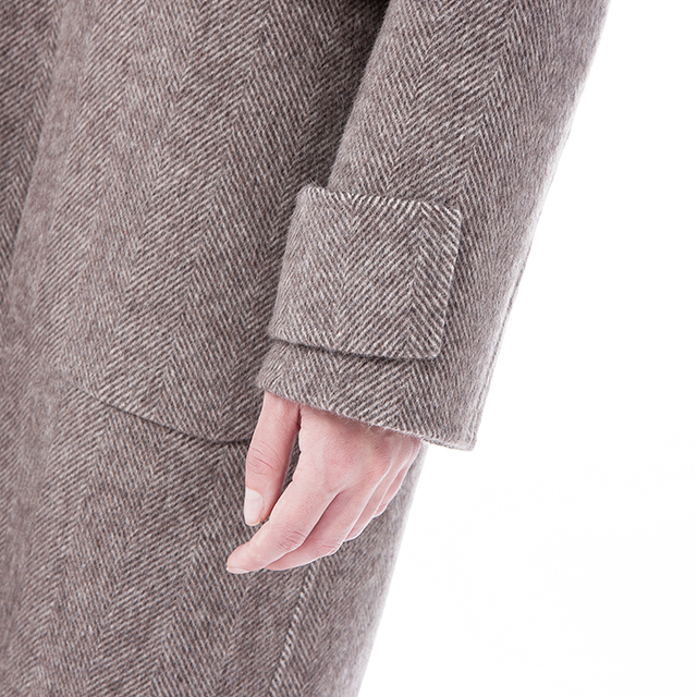 Camel coloured cashmere overcoat the sleeve