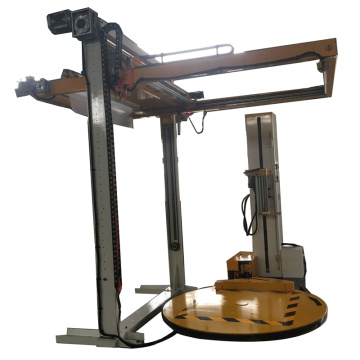 Pallet wrapping machine with Top sheet dispenser