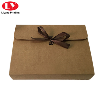 Kraft paper envelope with ribbon closure
