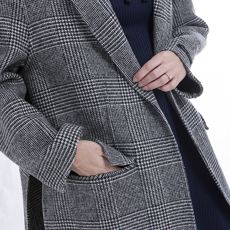 Pocket of fashionable striped cashmere overcoat