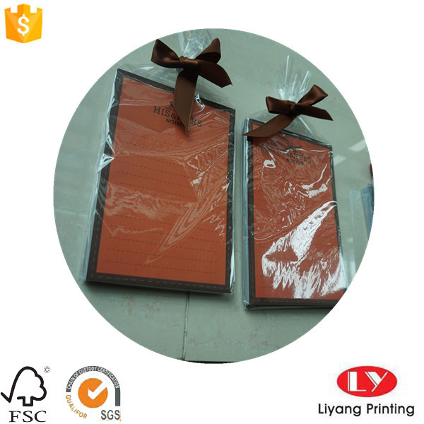 Luxury notepad with plastic bag and ribbon