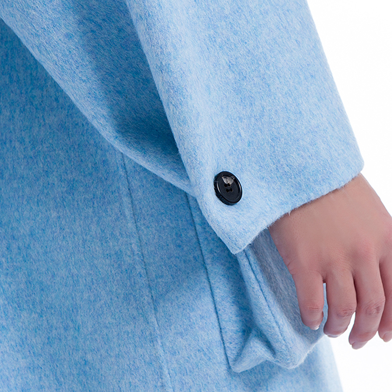 Sleeves of lady's classic cashmere overcoat