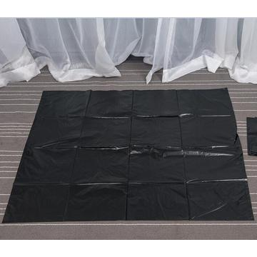 Large Black Garbage Bag on Sheet