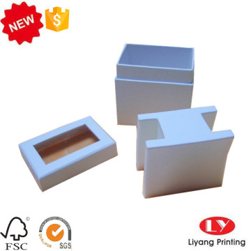 White cardboard gift packaging box with insert