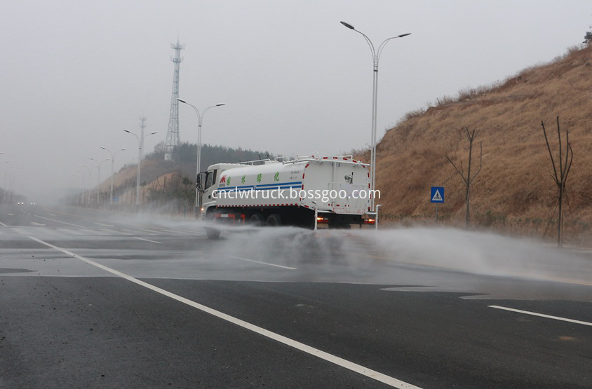 street water spray truck in action 1