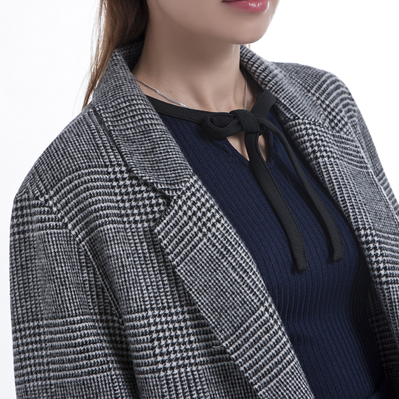 The collar of fashionable striped cashmere overcoat