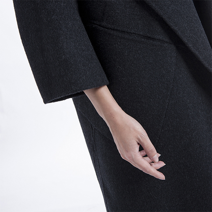 Sleeves of long black cashmere jacket