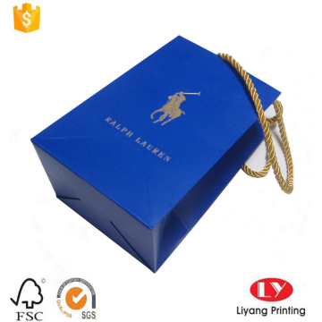 Small blue paper gift bag with handle