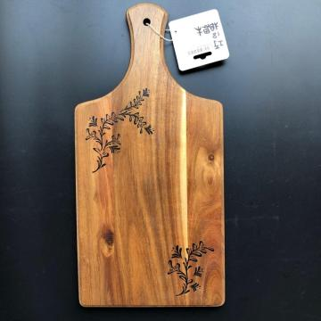 Wooden paddle cutting board with handle