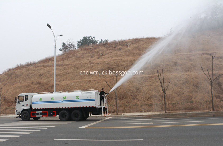 street water spray truck  in action 4